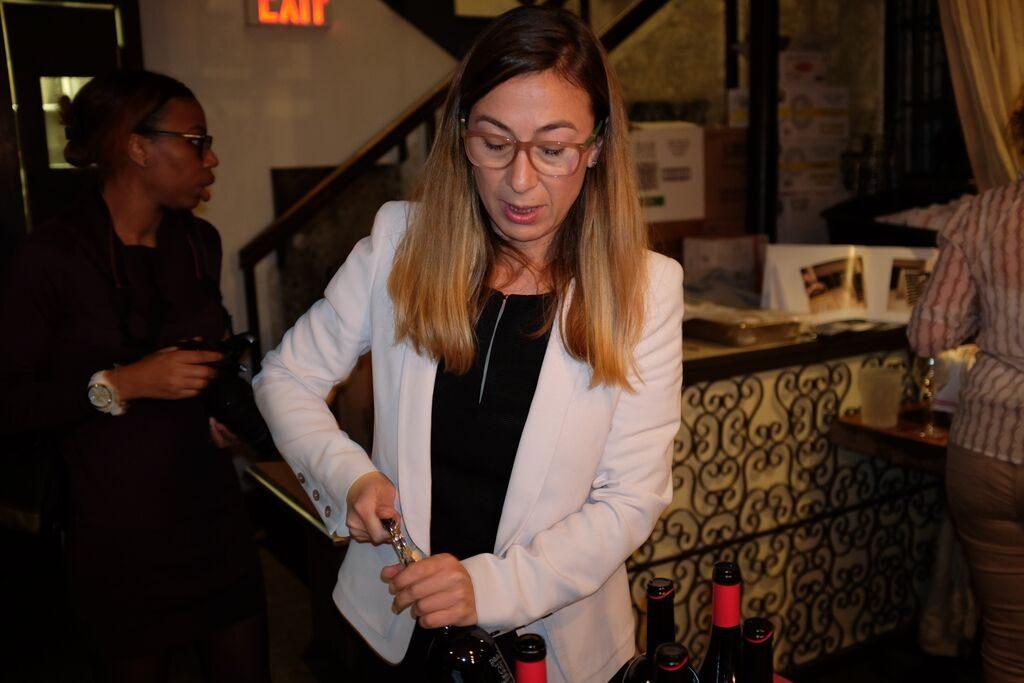 Raquel opening bottle